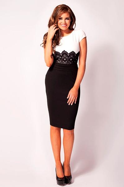 6012a5d32154 Super smuk figursyet kjole med overgang fra  sort skørt til hvid top